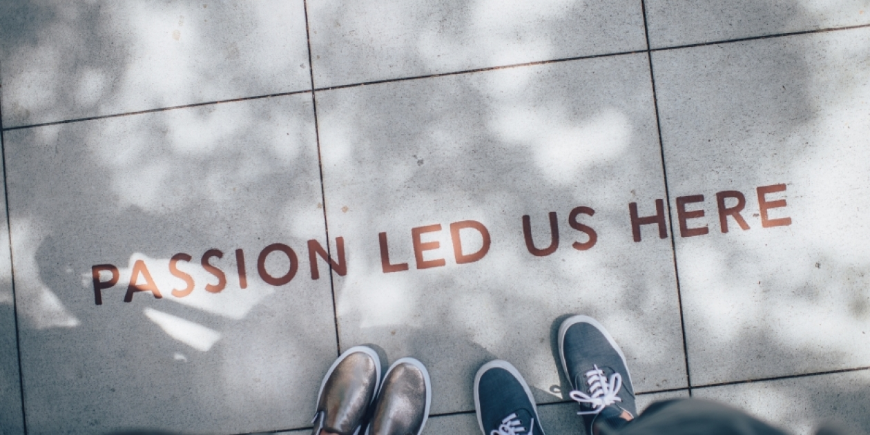 Image of feet with text that says passion led us here with a shadow over the cement squares