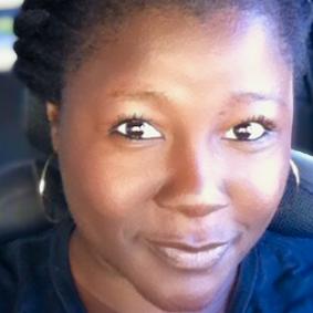 Sia Magadan Headshot, Director of Community Engagement