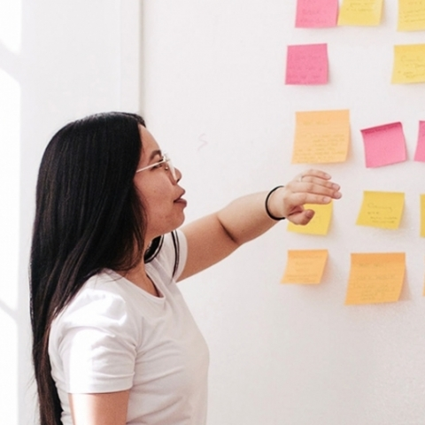 Image of woman with Post-It Notes