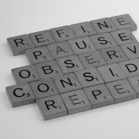 Image with scrabble tiles that says refine, pause, observe, consider, repeat